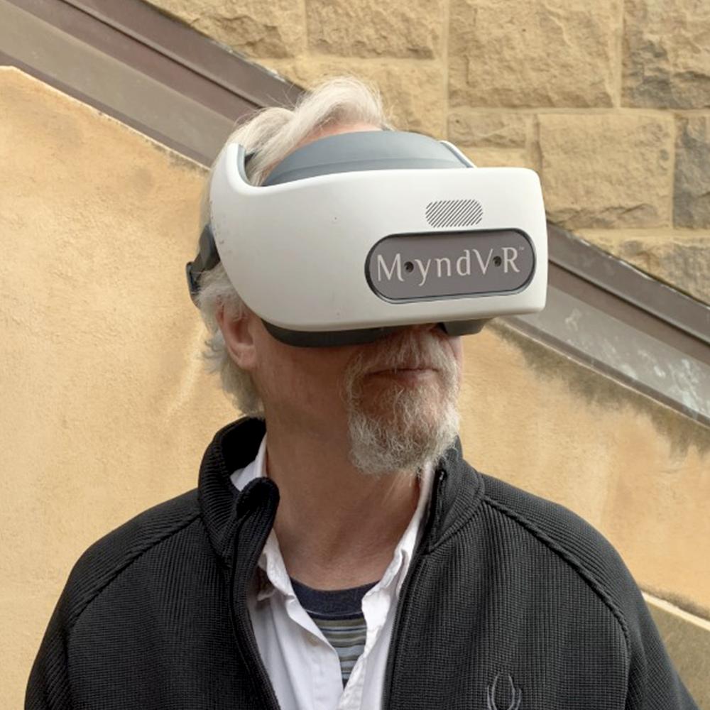 Older Adult in VR Headset